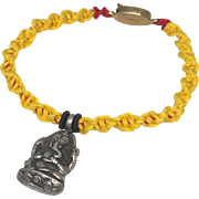 Sterling silver Ganesha charm with yellow  hand braided bracelet with gold plated silver clasp