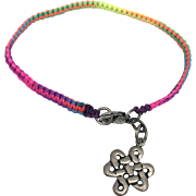 Sterling silver charm of an eternity symbol with a rainbow color hand braided bracelet and sterling silver clasp
