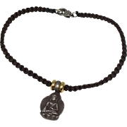 Sterling silver seated Buddha charm with brown hand braided macramé bracelet with silver clasp