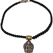 Sterling silver seated Buddha charm with black hand braided macramé bracelet with silver clasp