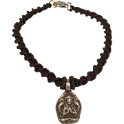 Sterling silver bodhisattva charm with brown hand braided macramé bracelet with silver clasp