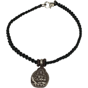 Sterling silver Jambhala, god of wealth charm with black hand braided macramé bracelet with silver clasp