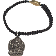 Sterling silver manjushri, god of wisdom charm with red hand braided macramé bracelet with gold plated silver clasp