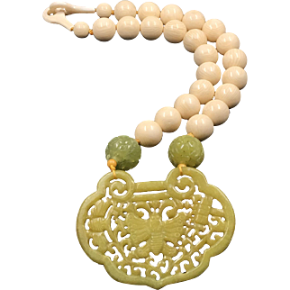 Hand carved yellow jade heart lock shape with butterfly, match with cream color resin bead and clasp