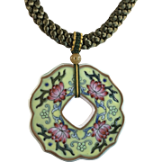 """Hand painted porcelain pendant in imperial yellow ground and four pink lotus matches with olive green silk braided necklace, length 18.5"""""""