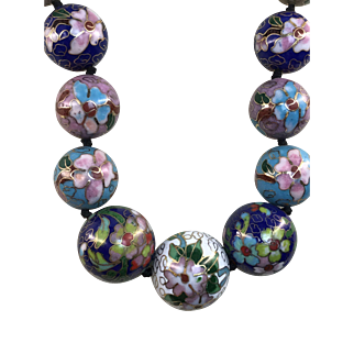 Necklace: multiple vintage cloisonné beads with pink floral design in different color and hand braided necklace with gold plated silver clasp