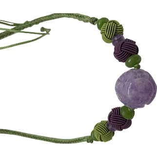 Adjustable necklace with a carved amethyst bead as  a focal, essence of hand braided and dyed knot bead in green and purple