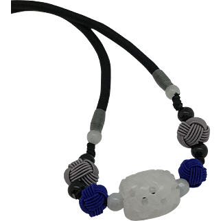 Adjustable Necklace with a carved barrel shape white jade bead as  a focal, hand braided and dyed knot bead in grey and royal blue
