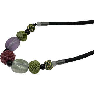 Adjustable necklace with a garnet beaded bead as  a focal, amethyst and green quartz bead, green and gold green knot bead.