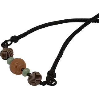 """Adjustable necklace with a carved cornelian beaded bead as  a focal, mocha knot beads, jade spacer, dark brown braided adjustable necklace, from 19"""" - 28"""""""