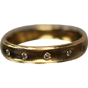 .05 CT Bezel Mounted Flush Fit Satin Finish Diamond Comfort Fit Band in 14k Yellow Gold
