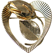 14K Highly Detailed Budding Flower Rose inside of Cut Out Heart with Florentine and Edged Finish in Yellow Gold