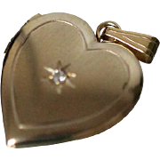 14k Hinged Heart Shaped Locket Pendant Charm with Diamond in Center in Yellow Gold