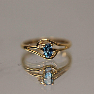 10KT Split Shank Oval Blue Topaz with Diamond Accent Ring in yellow gold