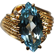 7.50 ct Vivid Blue Topaz in Fancy Beaded Cut Out Swirled 14kt Yellow Gold