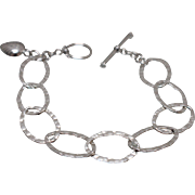 "925 - 7.75"" - Textured Oval Cable Link with Designer Heart Dangle & Toggle Clasp in Sterling Silver"