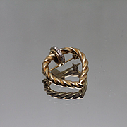 14kt - .03 ctw - Twisted Heart with Diamond Accents in Yellow & White Gold