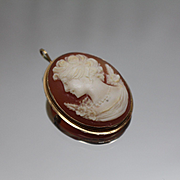 14k - Victorian Era Oval Carved Cameo with Rope Designed Bezel in Yellow Gold & Coral
