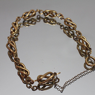 """18k 7.5"""" Fancy Textured & Gloss alternating Modernist Swirl Design Link with Safety Chain in Yellow Gold"""