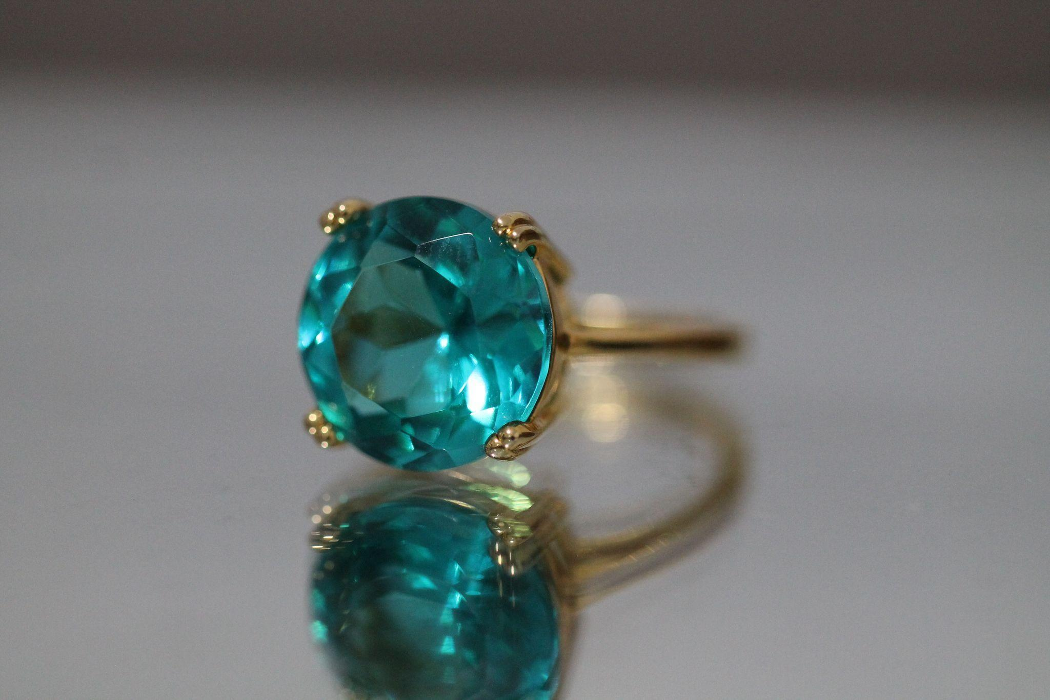 bright blue set in gold toned sterling silver