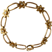 A Pretty French 18ct Gold and Diamond Flower Link Bracelet