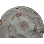 Vintage 6 well oyster plate with floral design in mint condition.