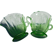 Pair of depression era Jeaneete glass green sugar and creamer flower pattern