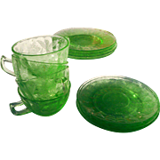 Four cups and saucers depression era by Jeanete glass co. green flowere design