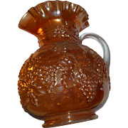 Large carnival marigold grape pattern applied handle pitcher