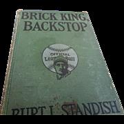 1914 edition of BrickKing backstop young men reading about baseball