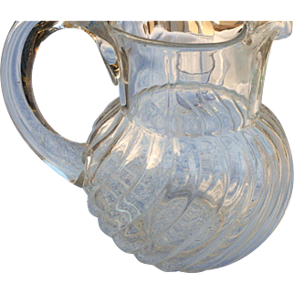 Vintage clear glass water pitcher in swirl pattern 7 1/2 inches tall in mint condition