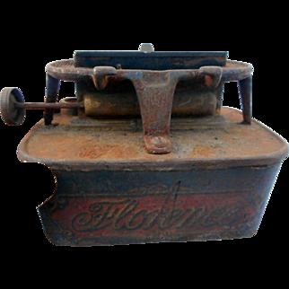 Circa 1900  one burner florence stove burner wrought iron