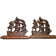 Pair of vintage cast iron sailboat book ends gld marked tronsiles