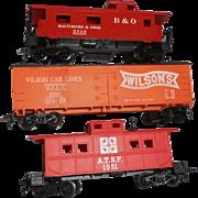 Three different Tyco h o railroad ars