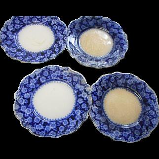 Four circa 1890 flow blue plates