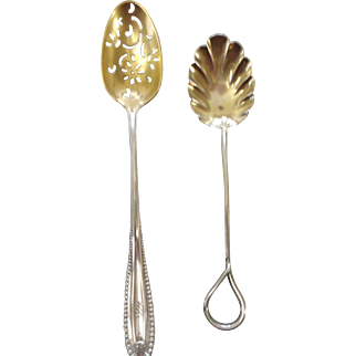 Two sterling silver spoons one sugar shell with wire handle and one perferated bowl6 1/2 inches long