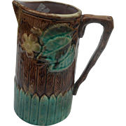 1920 circa Majolica 6 inches tall pitcher brown and green in color