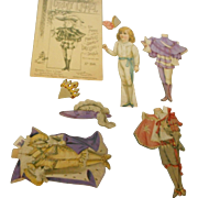 1894 Rapheal tuck dressing paper dolls and envelope
