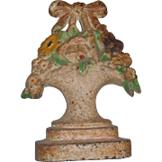 Circa 1890 cast iron basket of flowers door stop antique and as always your satisfaction is guranteed.