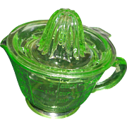 Green depresion glass reamer juicer with matching measure cup