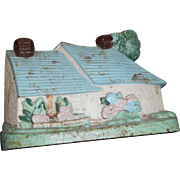 Vintage cast iron cottage door stop