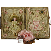 Marvelous Antique Miniature Bisque Doll in Elaborate Trousseau, Circa 1900, For the French Market With Supporting Theriault's Auction Catalogue