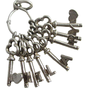Sterling silver name 'Hilary' heart key English charm vintage c1960