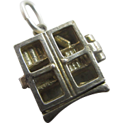 Nuvo sterling silver opening bookcase pendant charm Vintage c1960.