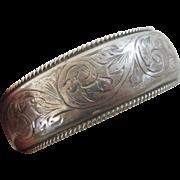 Sterling silver Chester engraved bangle bracelet vintage 1961 English hallmarks.