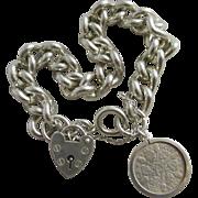 Chunky sterling silver chain link charm bracelet vintage 1977 English hallmark.