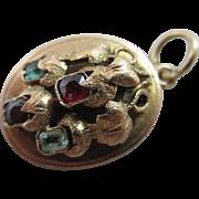 Hessonite garnet emerald 9k gold pendant locket antique Victorian c1860.