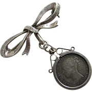 Sterling silver bow brooch pin dangling 4 pence coin pendant charm antique Victorian c1890.