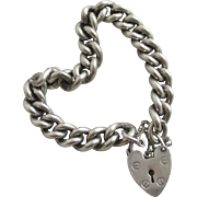 Chunky sterling silver chain link bracelet heart padlock vintage c1960 English hallmark.