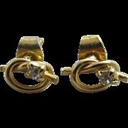Faux diamond 9k gold lovers knot stud earrings antique Edwardian c1910.